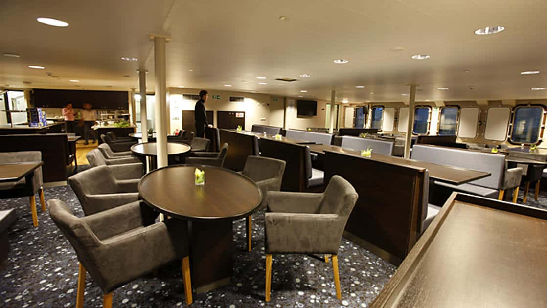plancius antarctica expedition ship dining room with tables, chairs and a bar