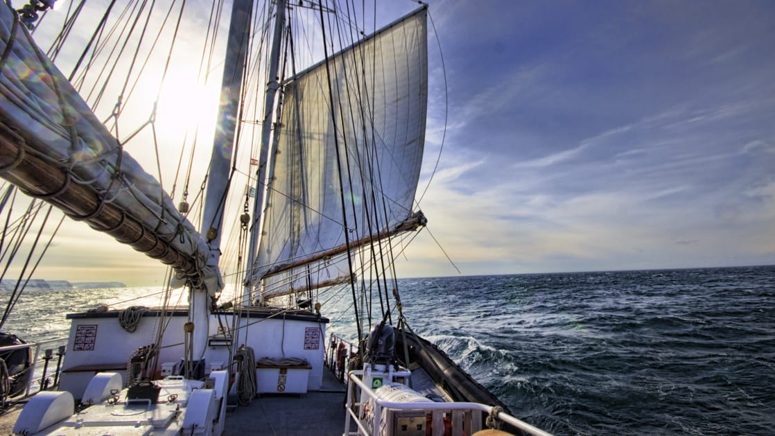 the Rembrandt van Rijn arctic small ship with sails up cruising on a sunny afternoon