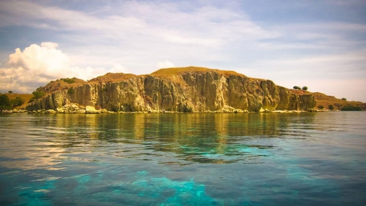 a green island seen from the ombak putih small ship on the sailing indonesia bali komodo flores cruise