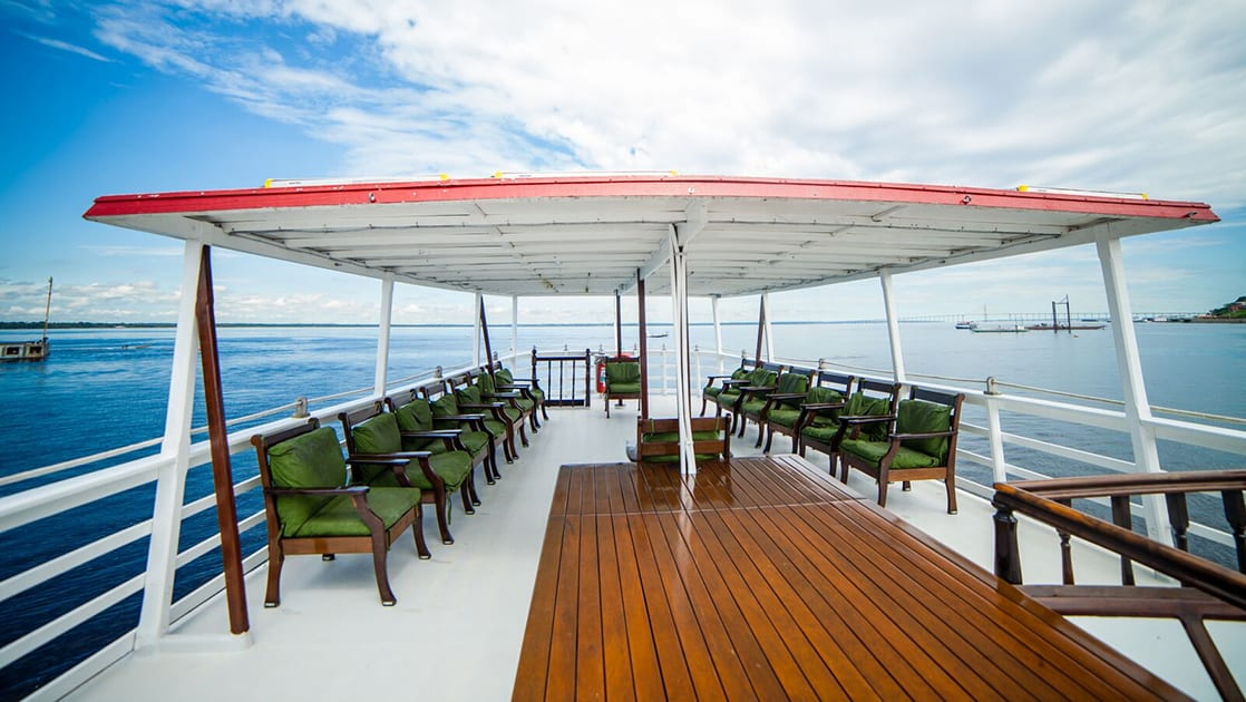 Aft deck with chairs aboard Tucano.