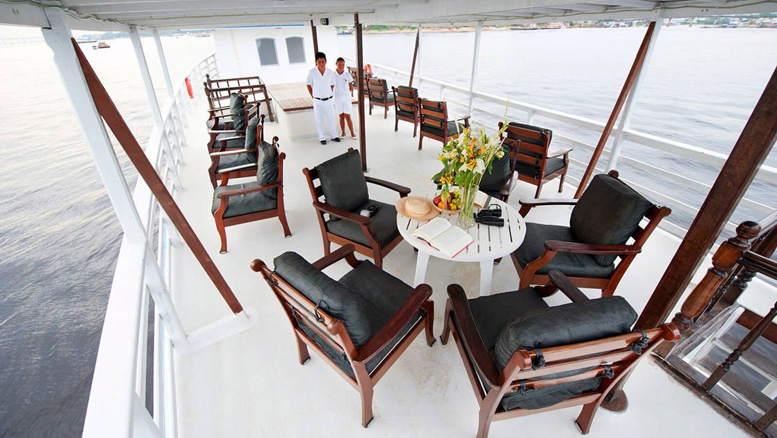 Chairs and table on the bow of Tucano.