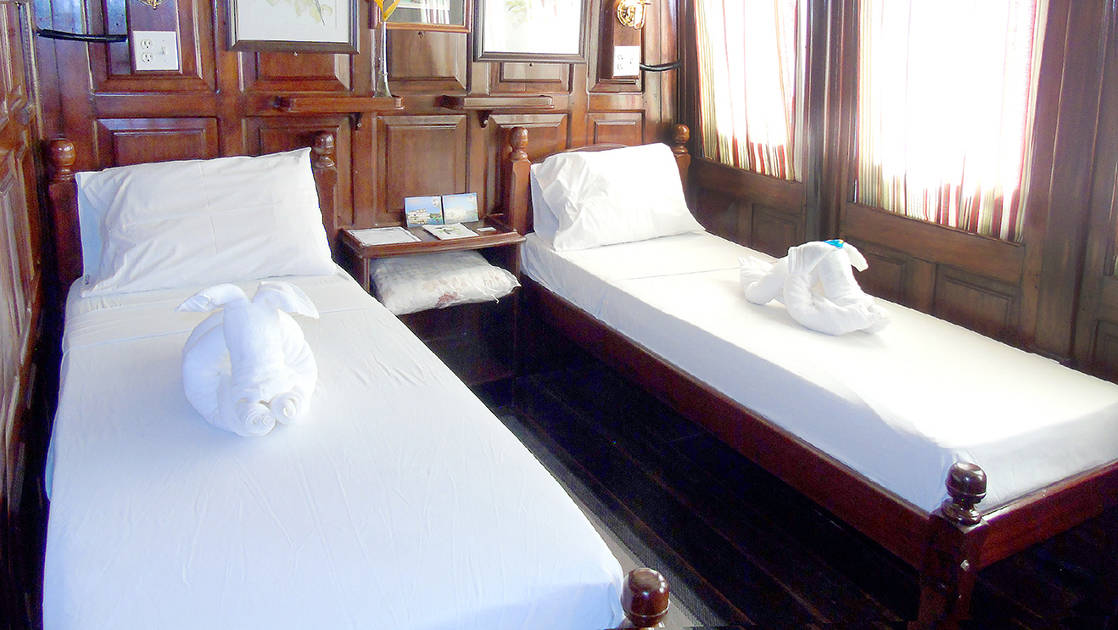 Yellow Category Cabin 4 with two single beds aboard Tucano.