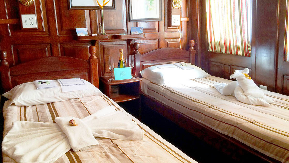 Yellow Category Cabin 5 with two single beds aboard Tucano.