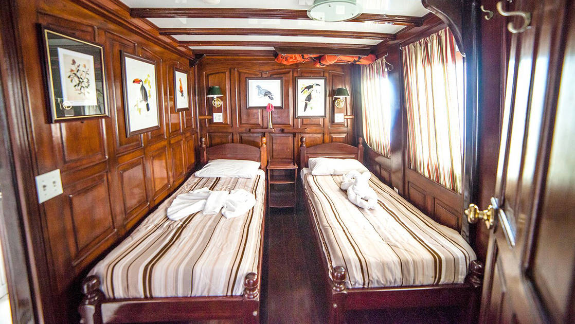 Yellow Category Cabin 6 with two single beds aboard Tucano.