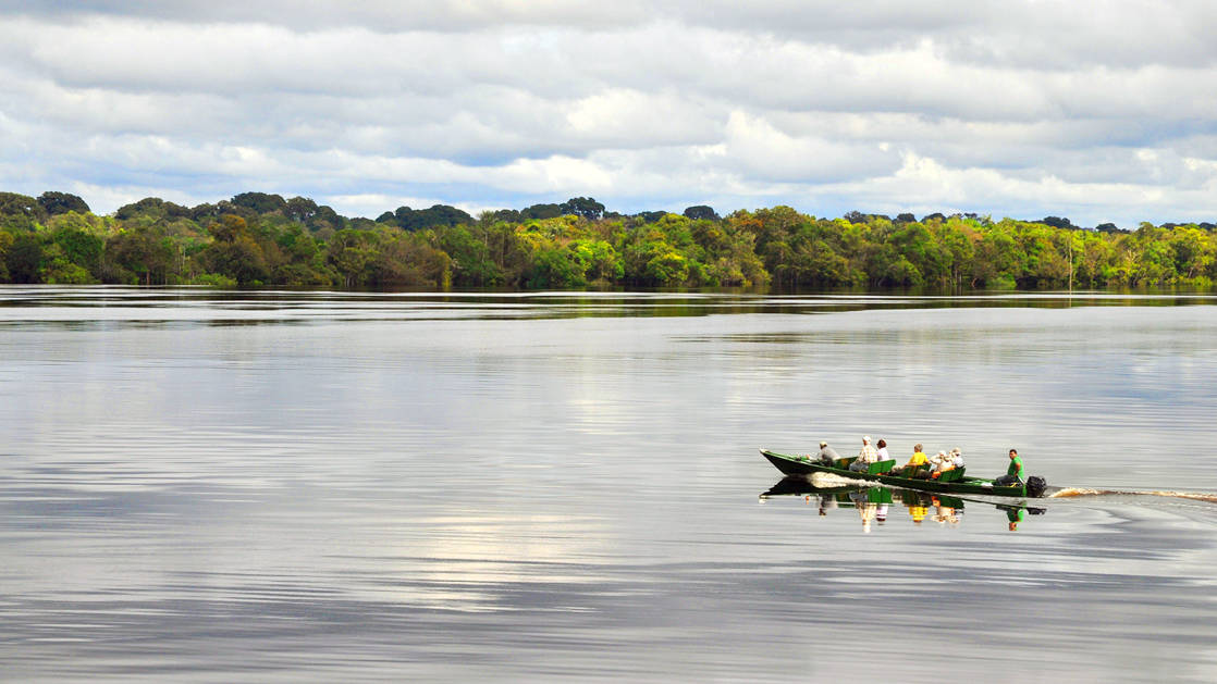 Canoe with cruise passengers going on an excursion on the rio negro in brazil