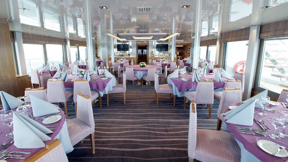 Dining room with tables set aboard Varitey Voyager.