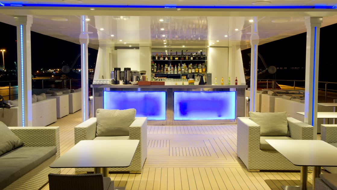 Lounge chairs and bar aboard Varitey Voyager.