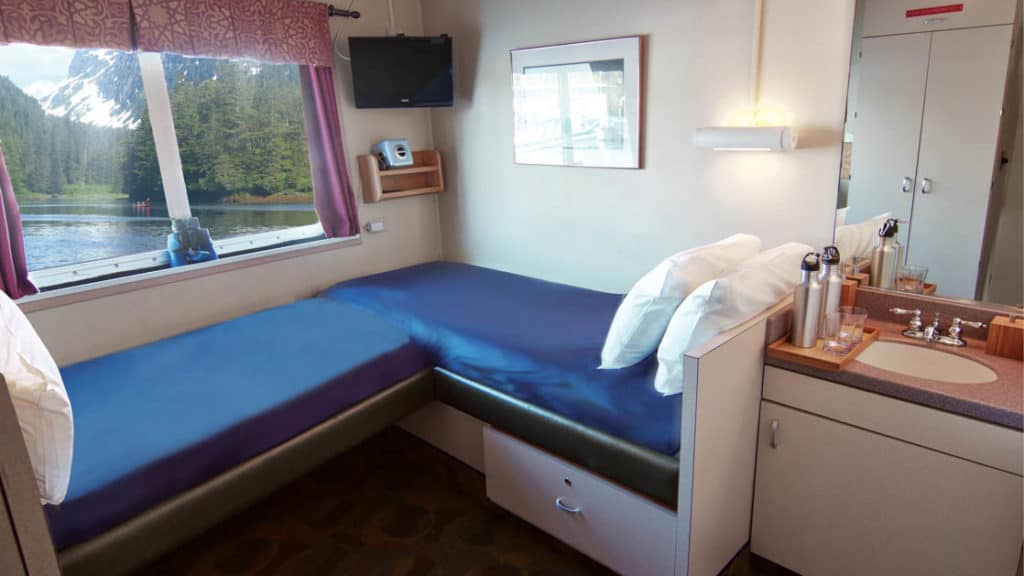 Navigator cabin 104 with fixed twin beds aboard Wilderness Explorer