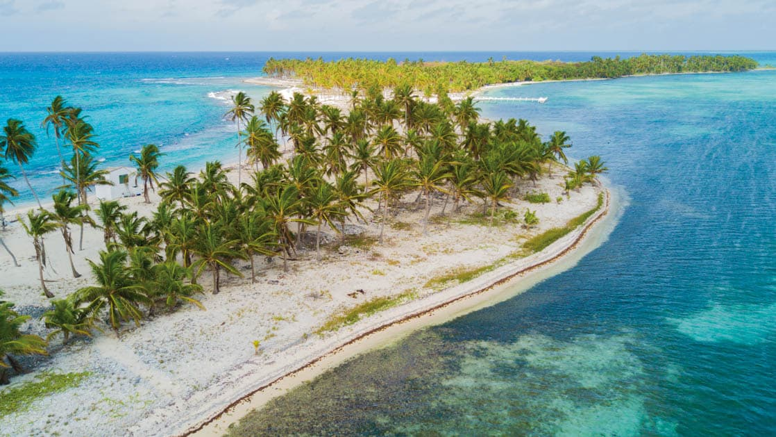 Aerial Shot of Half Moon Caye, an island and natural monument of Belize located at the southeast corner of Lighthouse Reef Atoll.