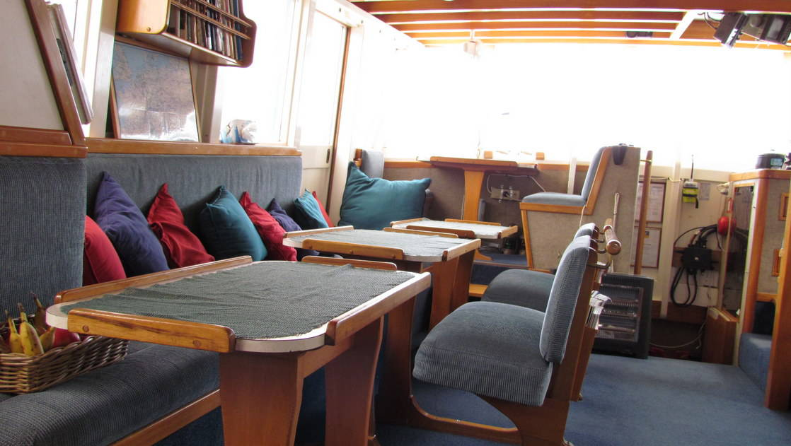 Sitting area and table aboard the Affinity.