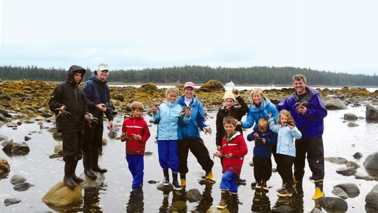 Family beachcombing in the tide pools in south east alaska