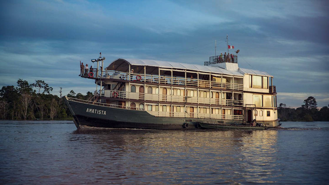 Amatista river boat cruising in the Peruvian Amazon.