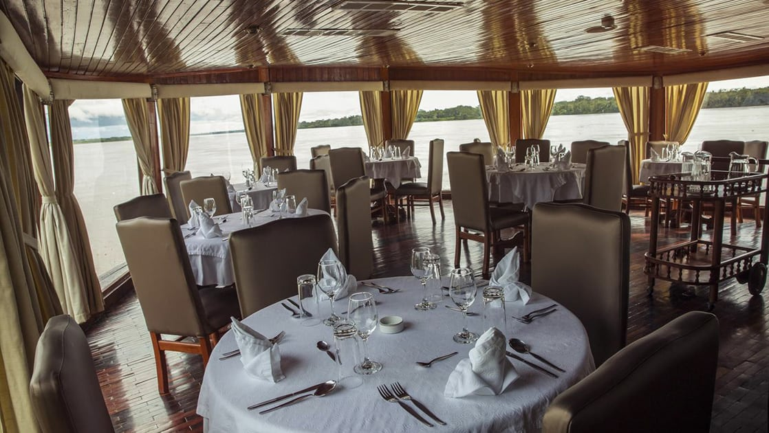 Set tables in the dining room aboard Amatista.