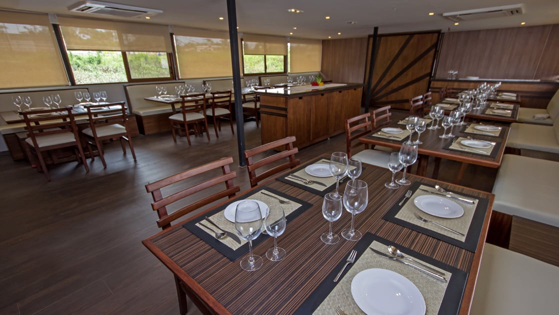 Dining room with 6 tables aboard Anakonda.