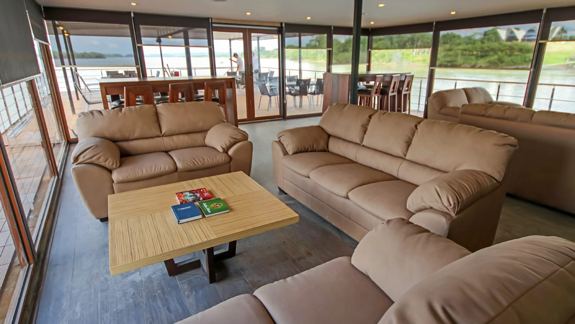Lounge with 4 couches and different seating areas aboard Anakonda.