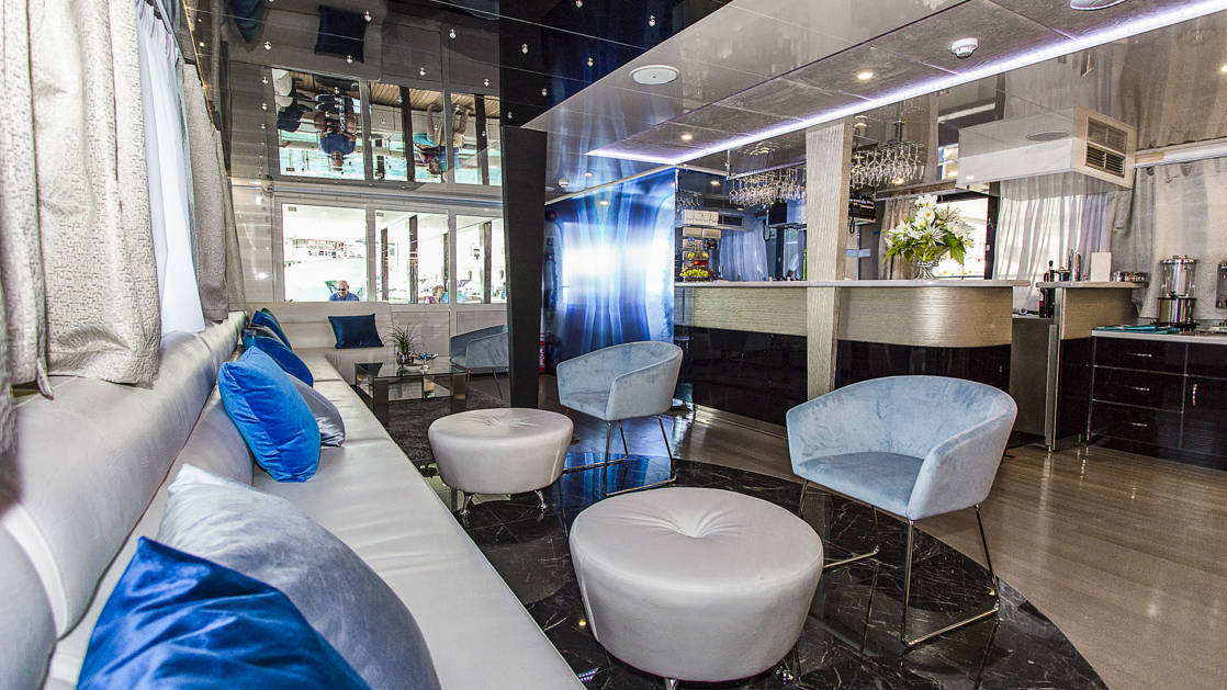 Indoor lounge and bar aboard Ave Maria.