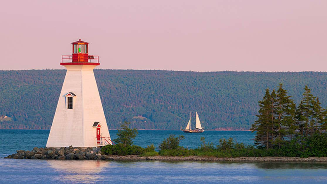 Lighthouse and sailboat in Labrador