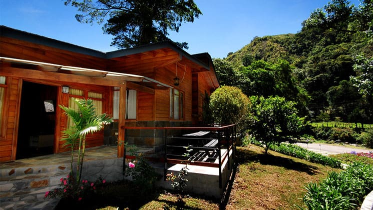 casa grande bambito exterior on a sunny day with lush forest behind it