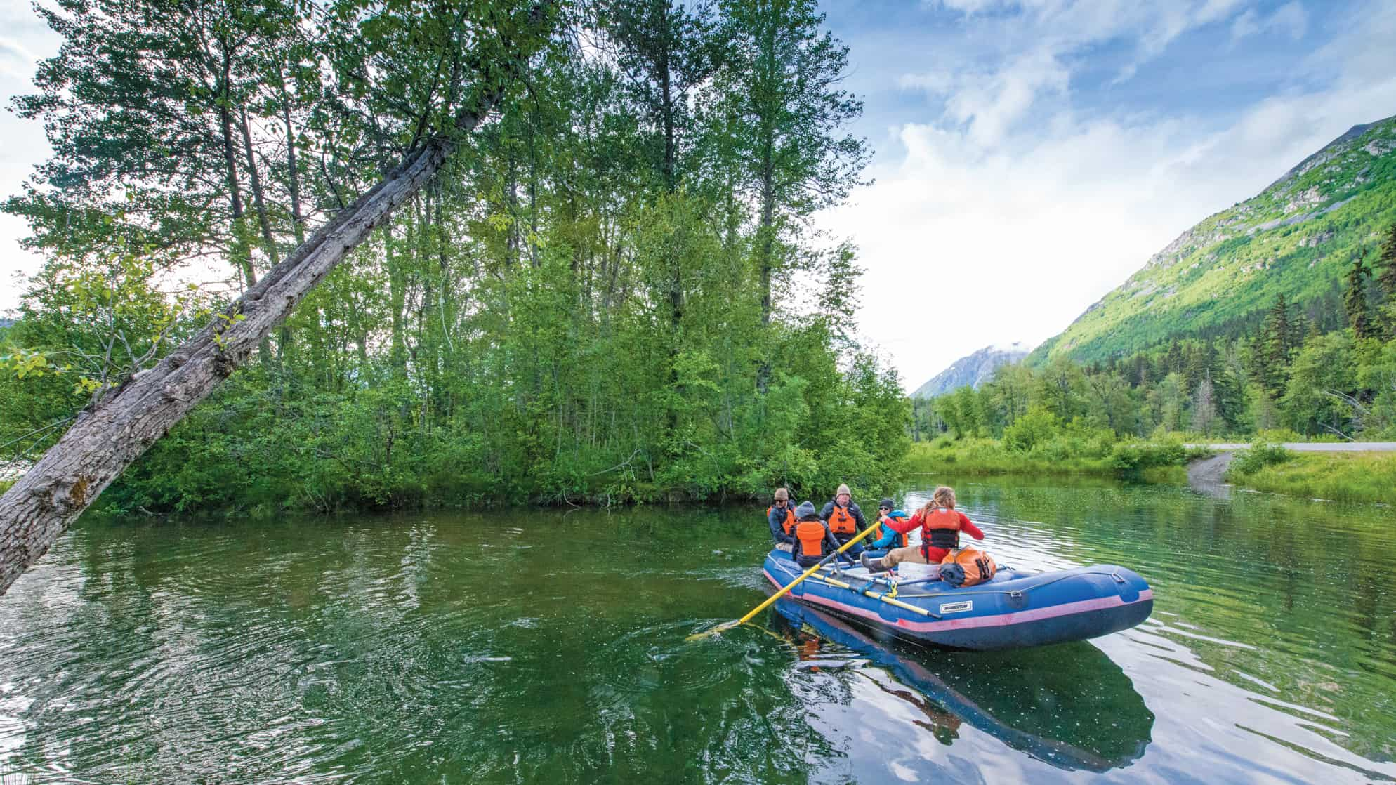 Small ship cruise guests rafting down the Chilkat River in Alaska's Chilkat Bald Eagle Preserve in Haines