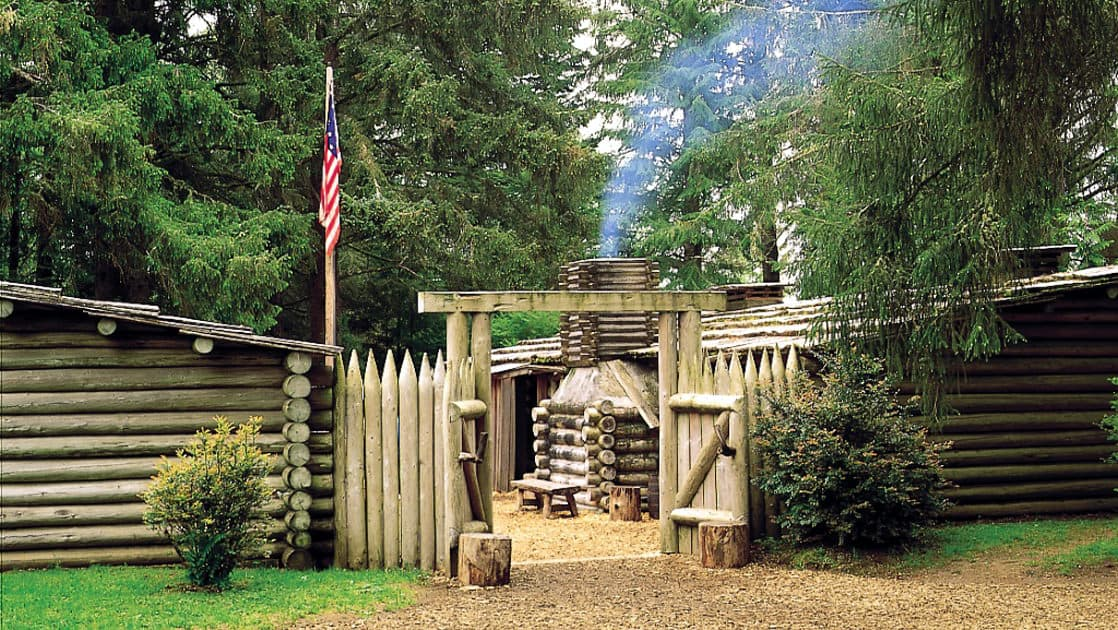 the entrance gate of fort clatsop near the columbia and snake rivers in the pacific northwest on a sunny day