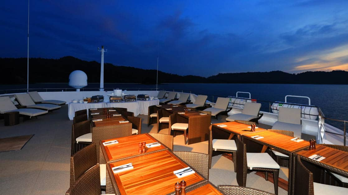 Outdoor dining on the sun deck aboard Coral Adventurer.