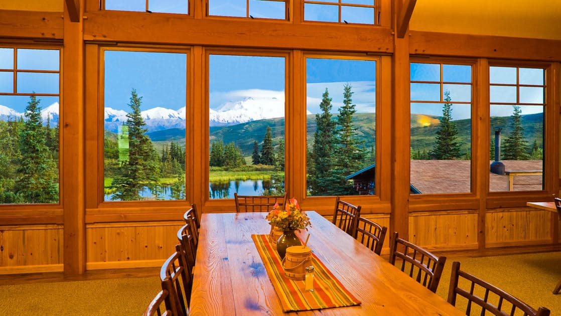 Wooden tables and chairs with fresh flowers and big windows boasting views of Denali National Park are where guests eat Alaska-grown meat and produce, including wild fish, pork, elk and reindeer products.