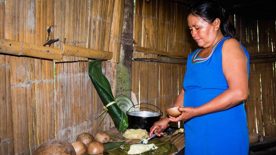 A woman cooks a meal at the kichwa community in the Ecuadorian Amazon basin, not far from La Selva Amazon EcoLodge
