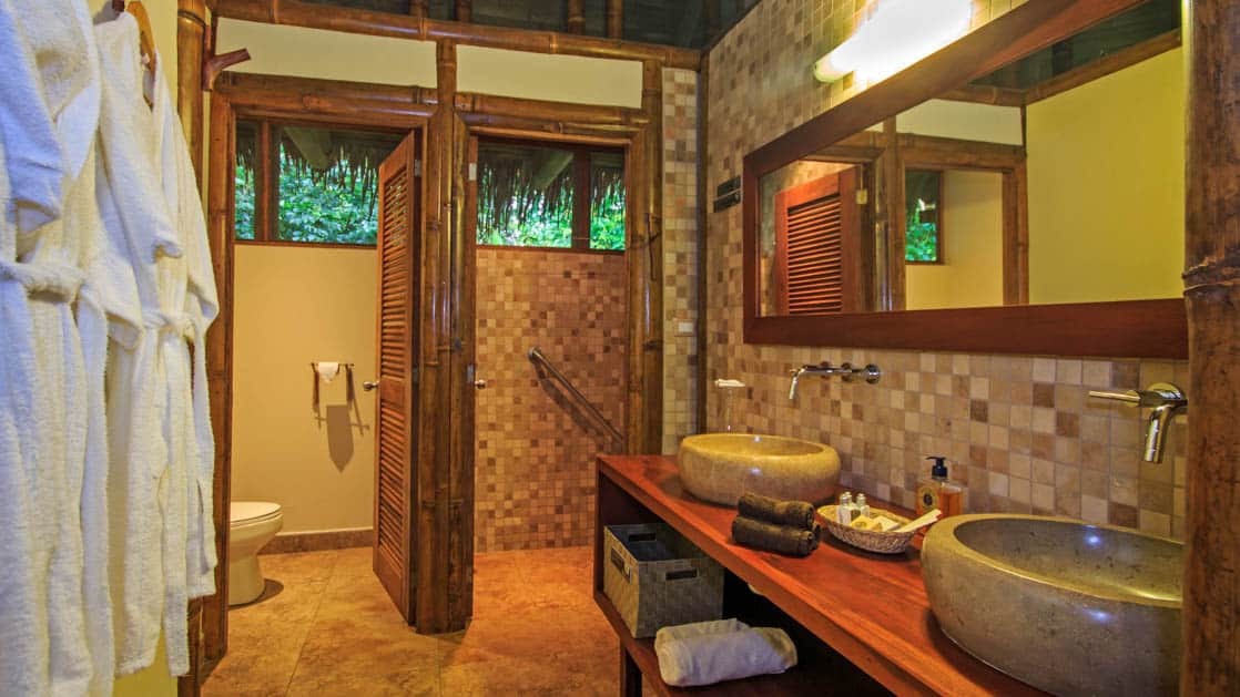 The bathroom in a superior suite features hot showers and L'Occitane products at La Selva Amazon EcoLodge, a sustainable, luxury accommodation in Ecuador