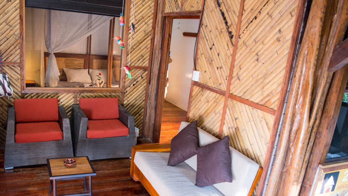Decorative wood walls, couches and chairs are a welcome place to relax on the deck just outside a suite at the Napo Wildlife Center, a luxury eco lodge surrounded by a rainforest biosphere reserve in the Ecuadorian Amazon.