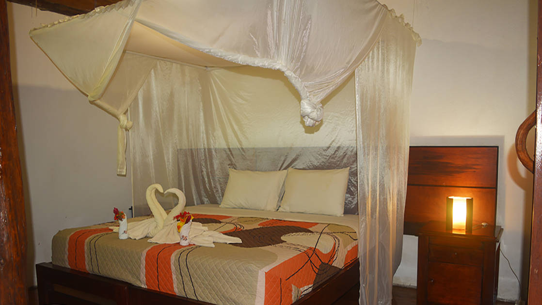 Towels are shaped into birds on the queen-sized bed with a mosquito net at the center suite of the Napo Wildlife Center, a luxury eco lodge surrounded by a rainforest biosphere reserve in the Ecuadorian Amazon.
