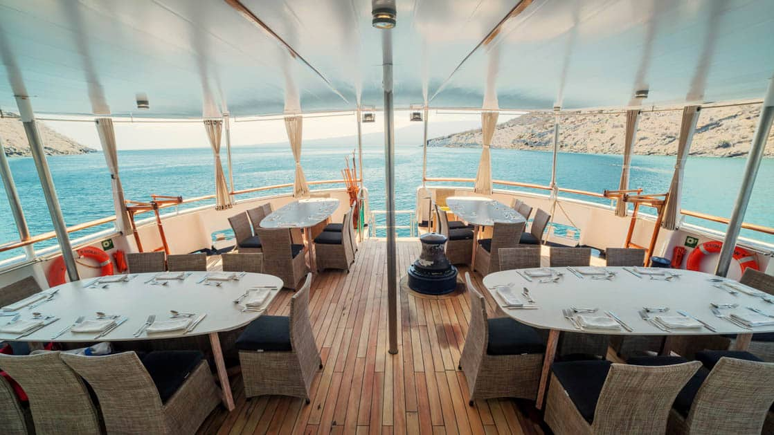 Outdoor deck table seating set for a meal on the stern of the Evolution.