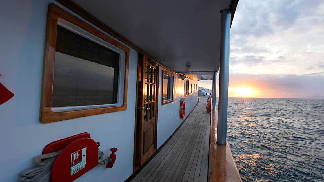 Balcony and stateroom of the small ship Evolution.