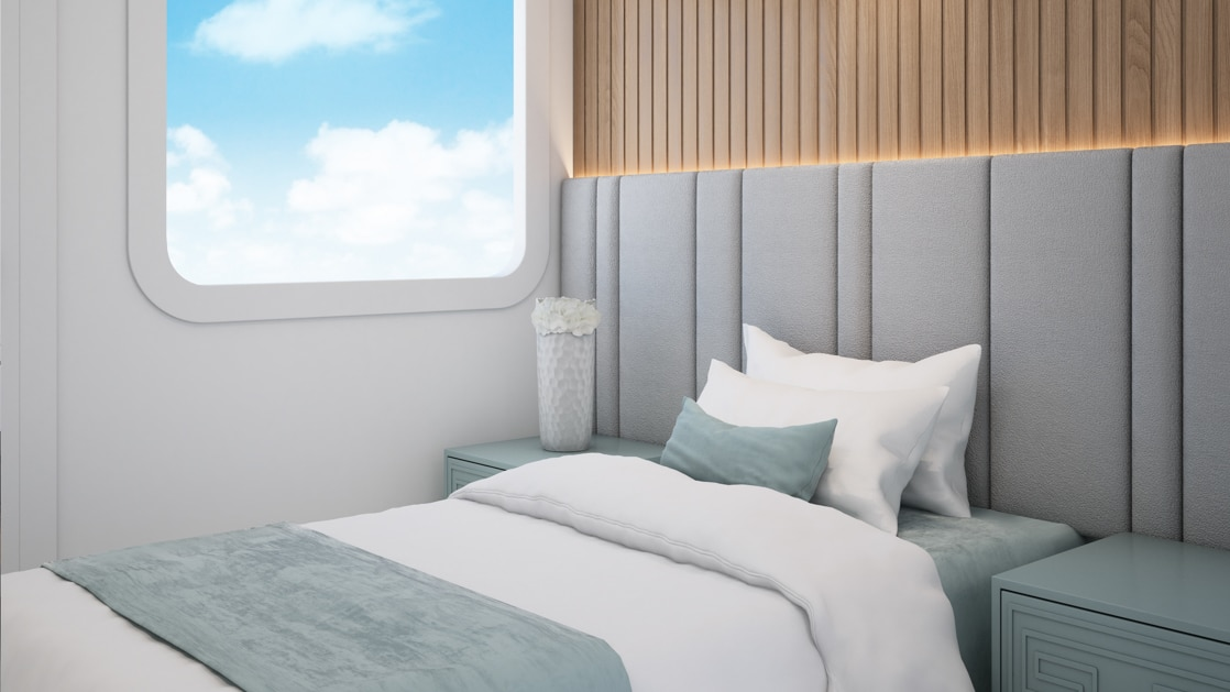 Single Stateroom aboard Ocean Spray with bedside tables and large window.