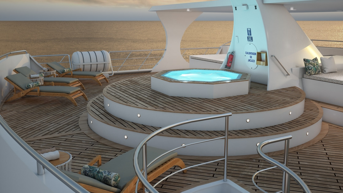Upper sundeck aboard the Ocean Spray catamaran during sunset in the Galapagos with lounge chairs and raised jacuzzi hot tub.