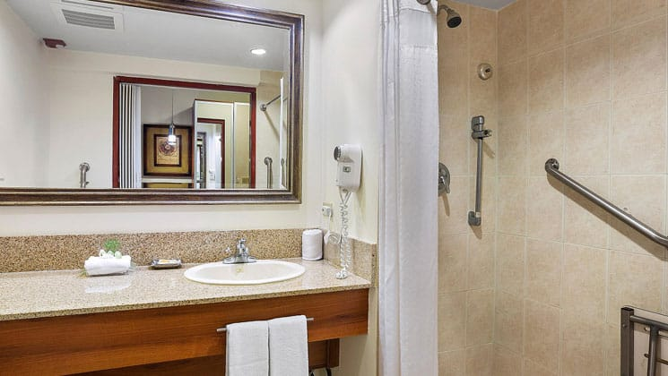 clean white bathroom with granite countertop and mirrors at the holiday inn panama canal