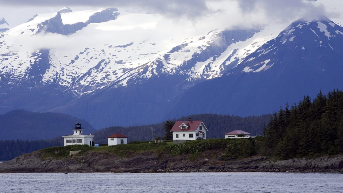 White cottages and lighthouse on an island in the inside passage of south east alaska