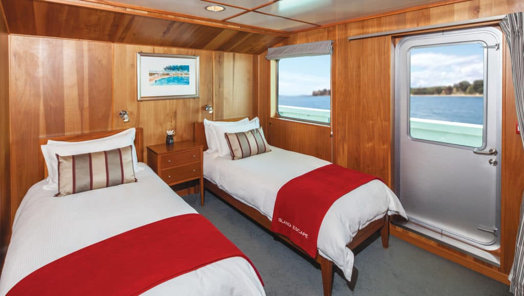 Ocean Suites aboard Island Passage feature twin or queen beds. The Kawau with twin beds pictured.