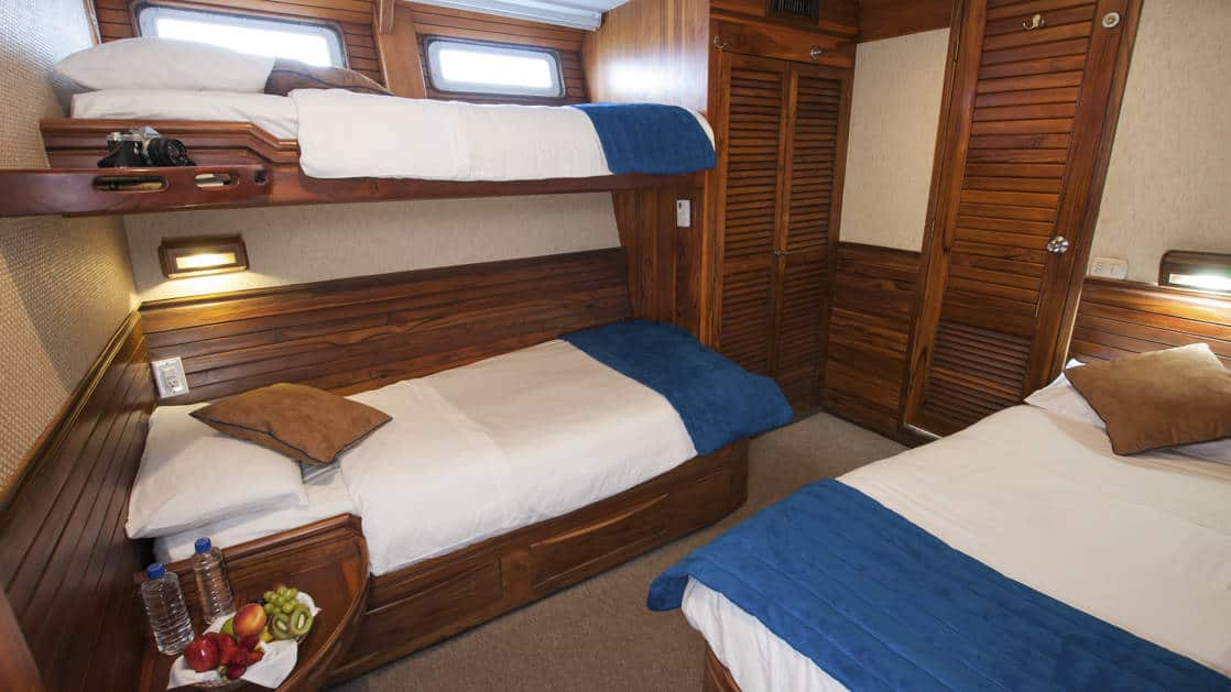 Letty stateroom Triple cabin with double bed and 2 twin berths, 2 windows, nightstand, closet and bathroom.
