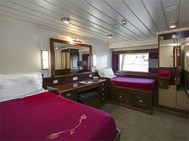 Lord of the Glens stateroom Category 2 Solo with 2 twin beds, dresser, large window and closet.
