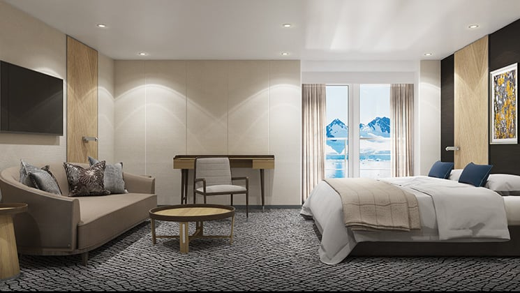 Penthouse Suite with king bed, private balcony and separate sitting area aboard Magellan Explorer Antarctica expedition ship