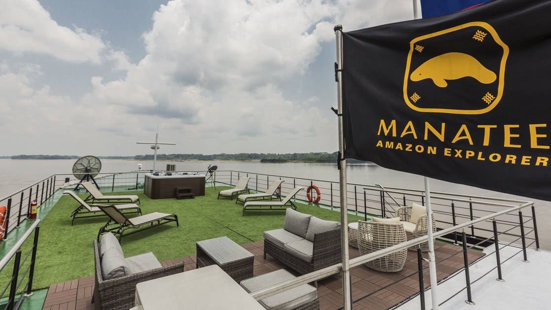 Manatee Amazon Explorer Observation deck with outdoor furniture and lounge chairs.