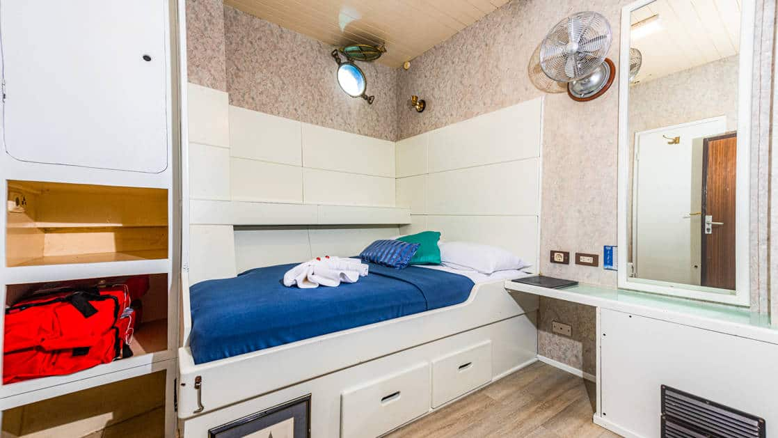 One twin bed with storage under bed aboard the Mary Anne in the Galapagos.