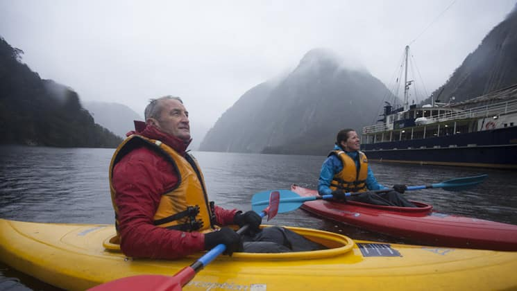 Milford Wanderer passengers enjoying a kayak paddle from the boat in New Zealand.