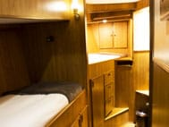 Misty Fjord Windham cabin with 2 twin berth, storage and window.