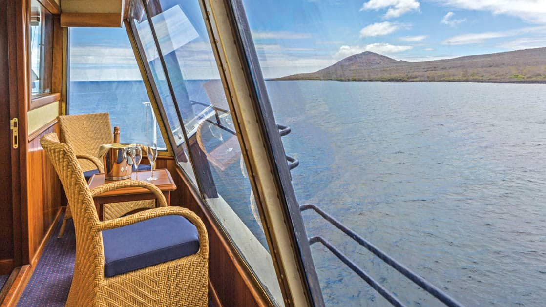 Table and chairs on private balcony aboard National Geographic Islander expedition ship in Galapagos Islands