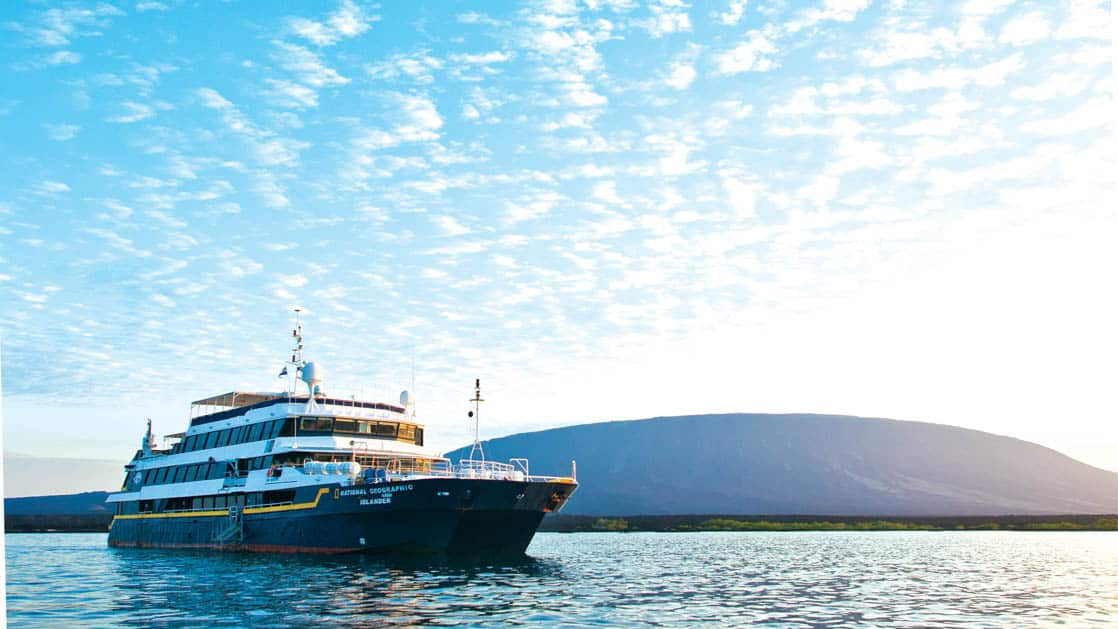 Full exterior of starboard side and bow of National Geographic Islander expedition ship in Galapagos Islands