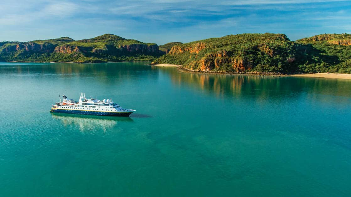 Aerial view of starboard side of National Geographic Orion expedition ship in calm waters