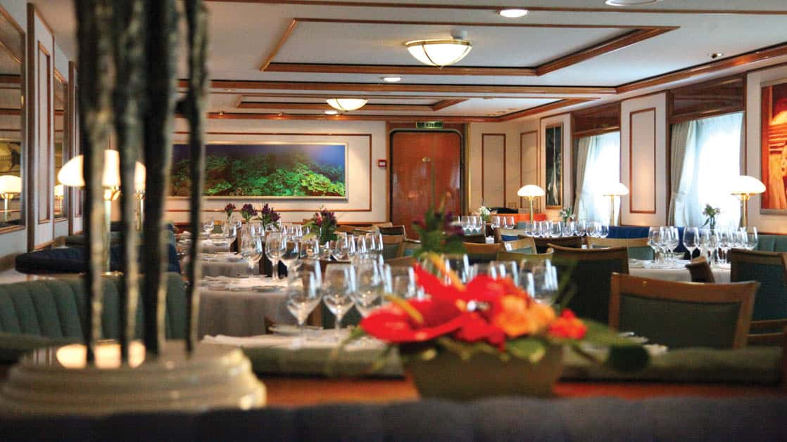 Fresh flowers in the elegant dining room on the National Geographic Orion expedition ship