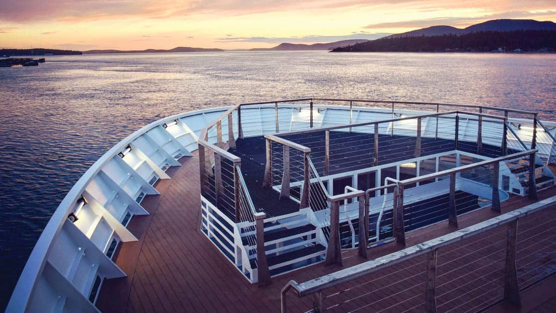 Sunset from bow of National Geographic Quest luxury expedition ship
