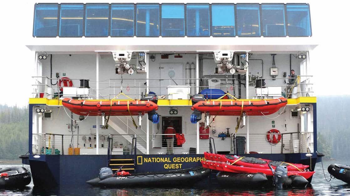 Zodiacs being placed in the water for shore excursions from stern of National Geographic Quest luxury expedition ship